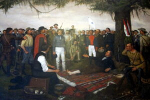 The Surrender of Santa Anna, painted by artist William Henry Huddle, has been on display in the first floor south wing of the Texas State Capitol since February 1891.  The painting depicts the morning of April 22, 1836, the day after Texas' victory over Mexico at the Battle of San Jacinto. Mexican General Antonio López de Santa Anna, in the uniform of a private soldier, was brought before Texas General Sam Houston as a prisoner of war. Houston, wounded in the battle, rested on a pallet under the oak tree while arranging an armistice with Santa Anna. To the right, seated on a log, was Erastus (Deaf) Smith, famous Texas scout; the captured Mexican battle flags were leaning nearby against the tree. To the left and rear of Houston was his Secretary of War, Thomas Jefferson Rusk, who was standing next to Colonel Mirabeau B. Lamar. Over thirty other historical figures were depicted in this painting.